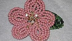 How to Make French Beaded Flowers. A relatively simple technique that looks simply amazing, French beaded flowers make lovely jewelry, home décor items and bouquet additions. Jewelry Findings, Jewelry Art, Beaded Jewelry, French Beaded Flowers, Flower Tutorial, Beading Tutorials, Handmade Flowers, Bead Crafts, Decorative Items