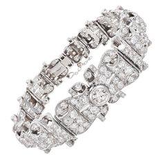 Elaborate Mid-Century Platinum and Diamond Bracelet | From a unique collection of vintage link bracelets at http://www.1stdibs.com/jewelry/bracelets/link-bracelets/
