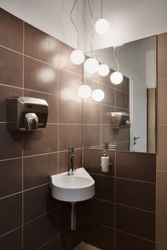 brown-ceramic-wall-tiles-decoration-with-pendant-lamps-with-hung-washbasin-mirror-without-frame-white-wall-paint-in-small-modern-bathroom-design-ideas.jpg (800×1200)