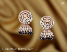 An eye-catching pair of earwear created in Diamonds and smokey Topaz. Diamond Earrings Indian, Diamond Jhumkas, Indian Jewelry Earrings, Diamond Necklace Set, Jewelry Design Earrings, Indian Wedding Jewelry, Gold Earrings Designs, Diamond Hoop Earrings, Bridal Jewelry