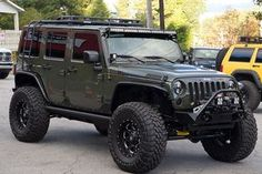 "Tank Jeep Wrangler Rubicon with AEV 3.5"" AEV DualSPort SC, Poison Spyder Crusher Flares and 37x12.50x18 Toyo Open Country MT Tires"