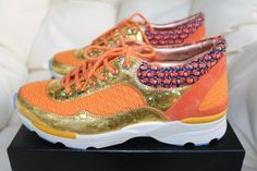 Get the must-have athletic shoes of this season! These Chanel Orange Logo Gold Tweed Suede Sneakers Tennis Trainers 36 Sneakers Size US 6 Regular (M, B) are a top 10 member favorite on Tradesy. Save on yours before they're sold out! Chanel 2015, Chanel Runway, Chanel Sneakers, Suede Sneakers, Orange Logo, Shoes 2015, Chanel Logo, Green Leather, Tweed
