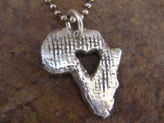 I have this necklace :) Some how, some way, I WILL go to Africa... To bring home a child, I don't know. But for so many years I have always felt that there is something I have to do there... Can't ignore God's calling, can I? :)