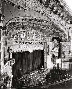 """During the silent era it was not un-common for a big palace to have an orchestra play along with the picture in addition to the stage show.  This is a shot looking down at the 100-piece orchestra pit risen up from it's depths below to stage level. The orchestra, like the organ consoles, could rise to various levels. Three-man organ """"solos"""" were presented on The largest Kimball organ ever constructed operated by three consoles rising in the front of the pit above the orchestra to """"Solo…"""