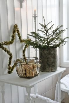 Put a spruce tip in one of my bronze buckets, then pinecones in one of my wire b. Put a spruce tip in one of my bronze buckets, then pinecones in one of my wire baskets and put on t