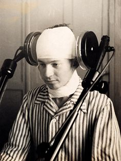 Diathermia,  using a galvanized current to jolt psychosis sufferers. A   patient undergoing lateral cerebral diathermia treatment in the early 1920's
