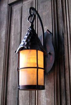 storybook or tudor style porch light with yellow pebble glass