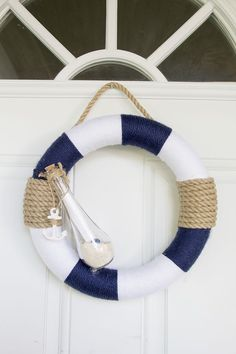 Turn your home into a beach house, even though it may be hundreds of miles away from the nearest beach, with this DIY nautical wreath! Coastal Wreath, Nautical Wreath, Seashell Wreath, Seashell Crafts, Nautical Theme, Nautical Baby, Nautical Craft, Nautical Sleeve, Nautical Quotes