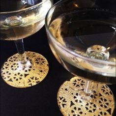 Dress up a set of thrift store stemware with a little glue and some gold doilies!