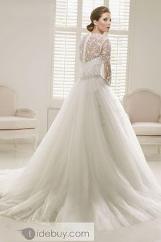 I tend to not look at long wedding gowns unless it's vintage, and simple. But this is beautiful. I like the sleeves, the back, and how it's not overly big but still makes a great statement.