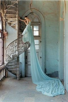 Sigh - I wish I had a stair spiral like that...and the frock...and the body to fit the frock. LOL.