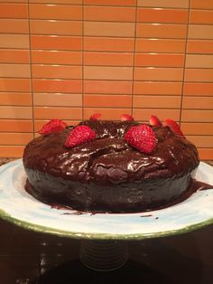 Vegan chocolate cake    Method:  Sift dry ingredients together in a mixing bowl.  Whisk the milk, maple syrup, oil, vanilla and vinegar in another bowl.