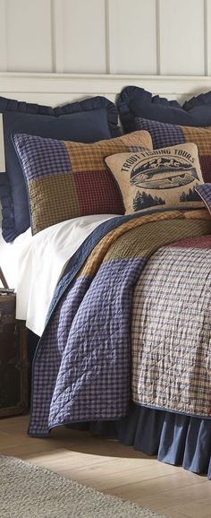 The Lakehouse Quilt Collection features a hopscotch quilt pattern with large panels of woven fabrics in shades of navy, tan, sage, burgundy, mustard, cream, and pumpkin finished with vertical diamond quilting. Using vibrant colors to blend with fabrics in varying shades is a time-honored tradition that takes talent and an eye for detail. A true classic that will work in all styles of decor. Accent pillows feature a fishing trip theme. #lakebedding #rusticbedding #coastaldecor #rusticbedding Rustic Bedding, Hopscotch, Cabin Design, Cozy Cabin, Home Bedroom, Coastal Decor, Bed Spreads, Accent Pillows, Bedding Sets