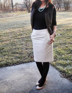 Fur vest and lace skirt