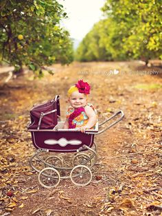 Maybe one day I will be strolling around a little girl! This pic makes me want one pronto! Uh Oh! Love the vintage stroller, the bright clothes and the happy baby :)   Photography by Julie Rollins http://www.julierollinsphotography.com/