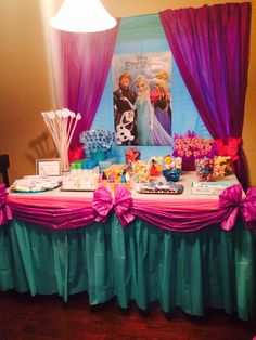 I Know This Is A Frozen Birthday Party Idea. Candy Buffet / Cake Table With  Anna And Elsa Poster. But I Love That This Is A Great Use Of Plastic Table  ...
