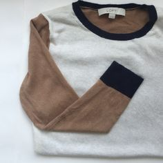 "Loft Colorblock Sweater Cream, tan & navy Loft colorblock sweater. Hand wash, dry flat. Blend of rayon, polyester, nylon & 5% rabbit hair. Front collar to hem 21"". Chest is 16.5"" across. Shoulder to shoulder 15.5"" LOFT Sweaters Crew & Scoop Necks"