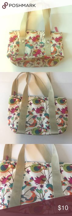 Lilly Bloom Lunch Bag Lilly Bloom Insulated lunch bag. Really cute cream with colorful birds. In great condition. Some wear on bottom but very minor. Preowned. Lilly Bloom Bags