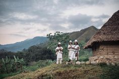 Credit to @natgeotravel  Photo by @taylorglenn // Men outside of a communal hut perched above banana and sugar cane crops in the village of Windiwa an Arhuaco community deep in the Sierra Nevada de Santa Marta mountains in northern Colombia. The Arhuaco are one of several tribes inhabiting this region that are descendants of the great Tairona culture. Their primary economy is subsistence agriculture in which they cultivate such crops as onions potatoes corn wheat various fruits and other…