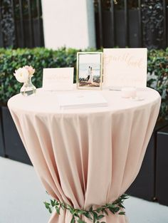 Blush linen guest book table: http://www.stylemepretty.com/2016/09/23/london-west-hollywood-rooftop-wedding/ Photography: Carmen Santorelli - http://carmensantorellistudio.com/
