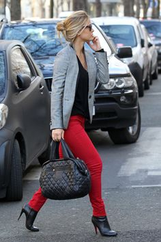red pants, grey jacket, black shoes.
