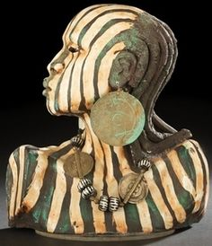 antiques price guide, antiques priceguide, sculpture, America, Woodrow Nash (American/Ohio, Contemporary), sculpted stoneware and glazed African female bust, her face and upper torso decorated in striped chocolate, green and tan, wearing large copper disc earrings, her neck adorned with a sculpted stoneware and copper necklace.