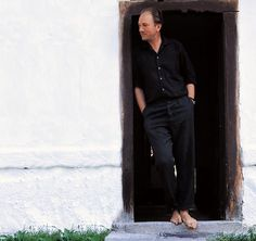 Austrian writer Thomas Bernhard stands barefoot at the door to his home Literature Books, Book Authors, Thomas Bernhard, Writers And Poets, Pants, German Language, Doorway, Barefoot, Room