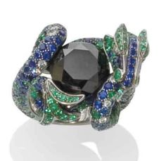 BOUCHERON DRAGON RING | Emeralds, sapphires, colored diamonds, and diamonds set in gold. Signed.