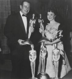 February 26, 2013~ On this day 60 years ago, JOHN WAYNE received the Henrietta World Film Favorite Actor at the Golden Globes! The Duke is photographed here with Favorite Actress, Susan Hayward.