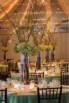 Tall centerpiece, lights across to bring high ceiling down