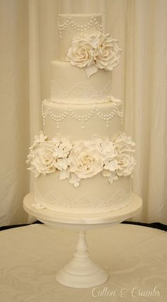 All ivory cake with ivory roses, hydrangeas and calla lillies