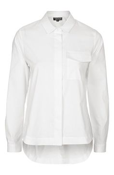Free shipping and returns on Topshop Neat Pocket Shirt (Nordstrom Exclusive) at Nordstrom.com. A covered placket and exaggerated shirttail hem with deep side vents keep the look clean and modern on this crisp, boxy-cut collared shirt.