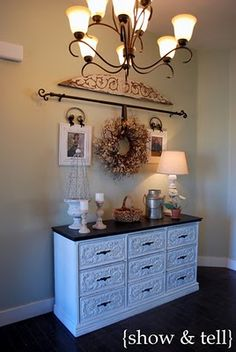 I plan on using the curtain rod to hang a quilt instead of a wreath.  Love the look this gives.