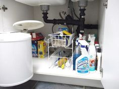 Organized and decluttered space under the kitchen sink {featured on Home Storage Solutions 101}