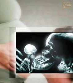 Even daddy skeletons love their babies.