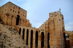 The Citadel of Aleppo, Syria. A UNESCO World Heritage site, excavations have shown it was a neo-Hittite acropolis. Major restructuring work took place in the late and early century. Islamic World, Islamic Art, Islamic Quotes, Architecture Wallpaper, Islamic Wallpaper, Aleppo, Geometric Art, Historical Sites, World Heritage Sites