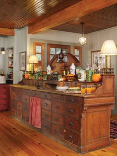 The repurposed cabinet, from an old drugstore, acts as a wet bar and provides additional storage for utensils, tools, and office supplies. Country Kitchen, New Kitchen, Vintage Kitchen, Kitchen Dining, Kitchen Decor, Kitchen Ideas, Warehouse Kitchen, Unfitted Kitchen, Kitchen Island With Sink