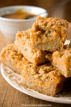 Pumpkin Spice Crumb Bars have delightful cinnamon crust and topping and silky Greek yogurt pumpkin filling. Pumpkin Spice Crumb Bars recipe - quick and easy fall dessert with pumpkin and spice. The crumb topping is irresistible! Fall Desserts, Just Desserts, Delicious Desserts, Dessert Recipes, Yummy Food, Brownies, Pumpkin Recipes, Fall Recipes, Yummy Recipes