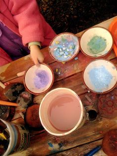 using mortar and pestle to grind chalk and then painting with the chalk