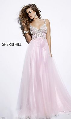 Get this celebrity inspired look for less when you order this elegant Sherri Hill prom dress for your next special event. Glittering beadwork adorns the bust and trails onto the ruched empire waistband of this stunning evening gown for prom. The A-line floor length skirt boasts an iridescent chiffon over layer for a romantic look and flattering fit for prom or party.