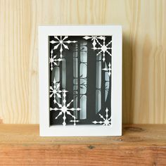 snowflakes & forest . 5 x 7 cut paper shadow box . hand cut . winter, snow, trees