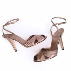 Gucci Leather Metallic Strappy High Heels Gorgeous Gucci shoes. Worn once. 36.5 B, made in Italy. Metallic toned leather with buckle ankle strap. Excellent condition with very minor wear- see photos. No box or bag. 100% authentic. Gucci Shoes Heels