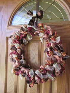 This is a cute wreath made out of any regular ribbon that you can get at hobbies Lobby or your nearest craft store.
