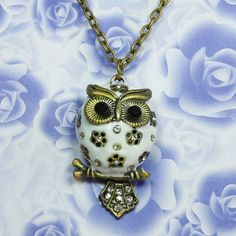 white enamel crystal flower Harry Potter  OWL necklace black eyes (tail can be moveable)