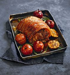 The apples are roasted alongside the pork shoulder in this roast recipe creating a sweet cider gravy.