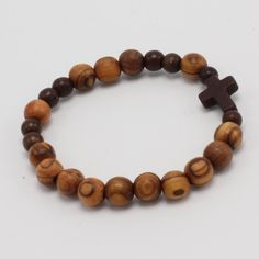 A modern cross boys bracelet - understated - it is just cool. Great for boys or girls on their First Communion. As always, everything will come ready to gift in our custom packaging. Remember to inclu