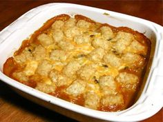 This tater tot casserole is made with tater tots, cheese, ground beef, golden mushroom soup and milk. Frozen vegetables make this cheesy tater tot casserole a meal in one dish.