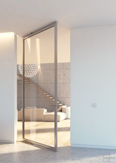 Modern glass pivot door with a silver anodized frame that houses our Stealth Pivot pivoting hinge. #portapivot