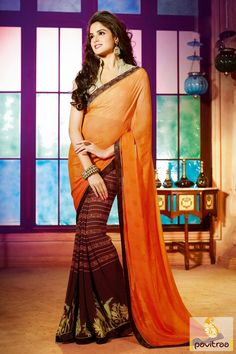 The gorgeous coffee and orange braso art silk special occasion party wear saree looks beautiful with its brown and orange printed work and lace patti work.