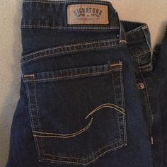 Levi's Signature Denim Levi's mid rise straight leg denim in dark blue. Never worn without tags. They were washed once and then i realized they didn't fit.  Levi's Jeans Straight Leg